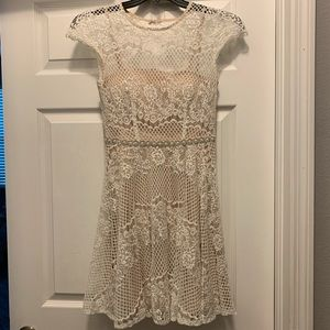 Lace dress with pearl beaded belt